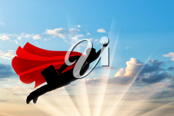 Superman businessman superhero. Silhouette of a businessman in the image of a superman flies in the sky with a briefcase on dawn