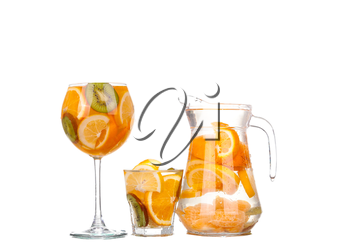 collage pitcher with a refreshing drink with lemon slices of orange and kiwi on white background