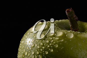Macro of freshly picked green apples with water droplets.