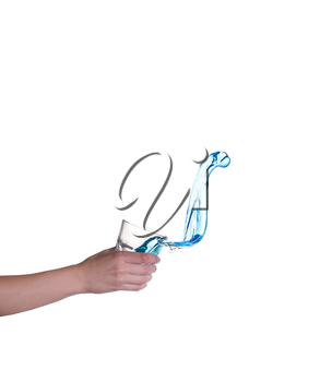 Blue water splashing in glass held by hand, white background