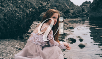 beautiful young girl in the morning under the water. Mysterious Woman in White Dress, vintage filter