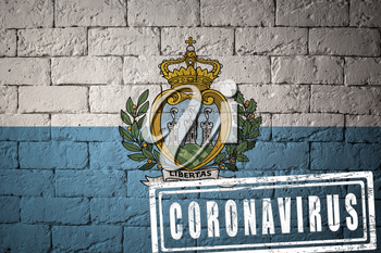 Flag of the San-Marino with original proportions. stamped of Coronavirus. brick wall texture. Corona virus concept. On the verge of a COVID-19 or 2019-nCoV Pandemic.