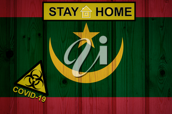 Flag of the Mauritania in original proportions. Quarantine and isolation - Stay at home. flag with biohazard symbol and inscription COVID-19.