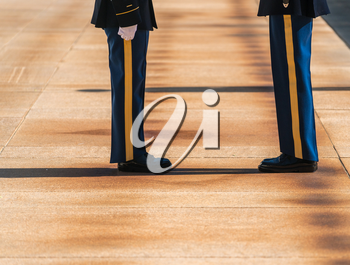 Detail of uniforms and legs of Honor Guard at tomb of unknowns in Arlington Cemetery
