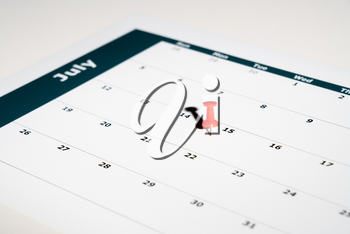 Reminder for sending income tax return for July 15 2020 tax day due to Covid-19 virus delay using calendar page and pin