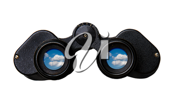 Old black binoculars view from behind in which a blue sky and clouds can be seen