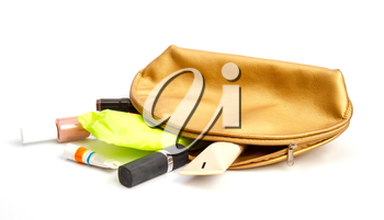 White feminine sanitary pad falling out of a cosmetic bag along with a variety of contents