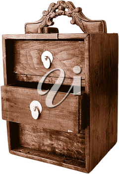 Royalty Free Photo of a Vintage Night Stand With Drawers