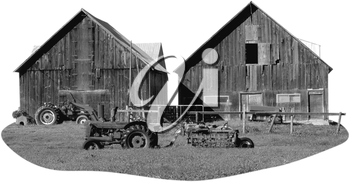 Royalty Free Black and White Photo of Two barns and Tractors