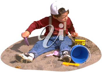 Royalty Free Photo of a Boy Playing in the Sand