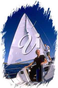 Royalty Free Photo of a Couple on a Sail Boat