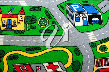 Children�s carpet with roads and buildings.