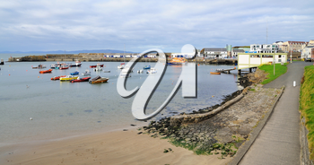 Small harbour with boats in the Portrush city, Northern Ireland.