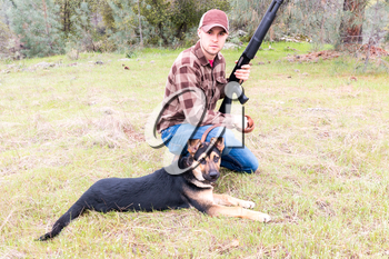 Young Man Hunting With Dog