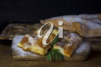 Apricot Cake With Mint Leaves On a Rustic Wooden Board