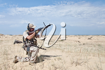 US marine aiming a gun with grenade launcher