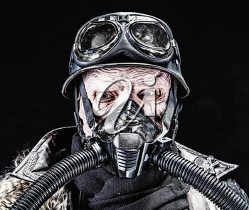 Ugly face of Futuristic nazi soldier in gas mask and steel helmet. Skin burned by atomic flame