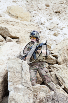 Female member of Navy SEAL Team with weapons in action