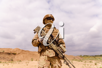 Equipped and armed special forces soldier with sniper rifle. Concept of military anti-terrorism operations, special operations of NATO forces.