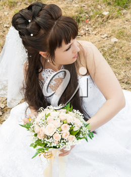 Bride with a bunch of flowers, in a wedding dress