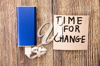 Motivational message for moving on with changes. Time for change motivational concept on white paper. Handwritten motivational messages. Wooden retro backgrounds.
