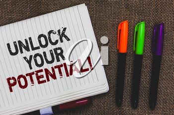Text sign showing Unlock Your Potential. Conceptual photo improve self awareness Skills to Achieve more Open notebook page jute background colorful markers Expressing ideas