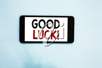 Text sign showing Good Luck. Conceptual photo A positive fortune or a happy outcome that a person can have Cell phone white screen over light blue background text messages apps