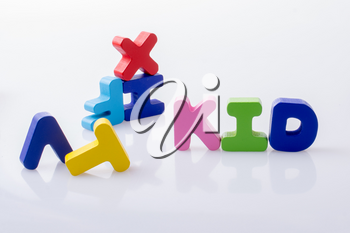 the word KID written with colorful letter blocks on white