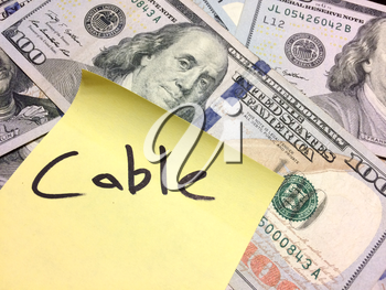 American cash money and yellow paper note with text Cable in black color aerial view