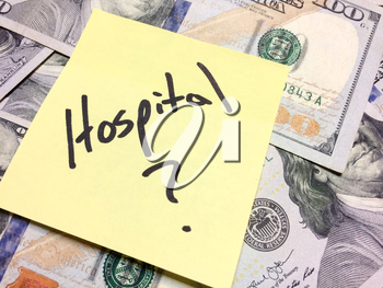 American cash money and yellow paper note with text Hospital with question mark in black color aerial view