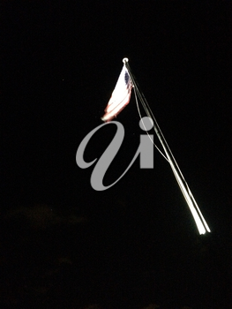American flag on flagpole motion background black at night with spotlight