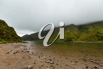 The fine, sedimentary beach of Lagoa do Fogo, with view of crater rim