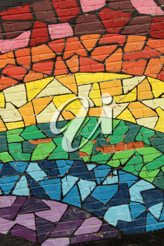 Colourful rainbow painting on a wall representing gay community